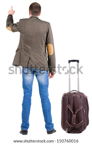 Back view of traveling business man with  suitcase pointing. Rear view people collection.  backside view of person.  Isolated over white background.