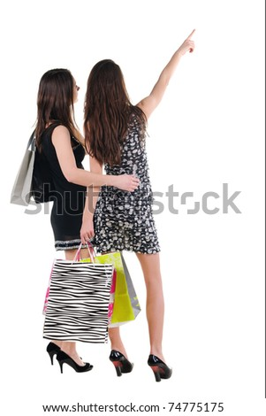 Back view of two girl with shopping bag. rear view. Isolated over white.
