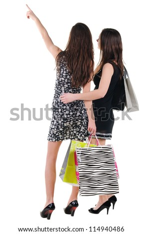 Back view of two woman with shopping bag. Rear view people collection.  backside view of person.  Isolated over white background.