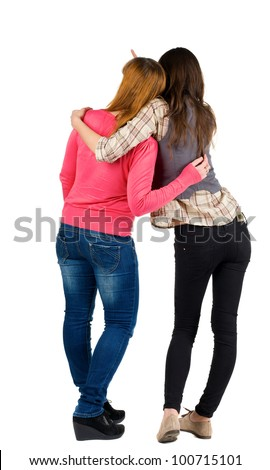 Back view of two young girl  pointing at wall . Rear view people collection.  backside view of person. beautiful woman friends  showing gesture. Rear view. Isolated over white background. - stock photo