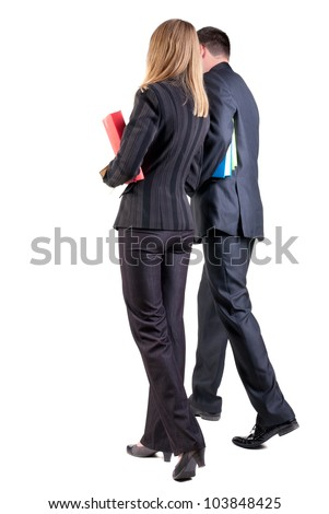 Back view of walking business team. Going young couple (man and woman) with books. girl and guy in suit together. Rear view people collection. backside view of person. Isolated over white background