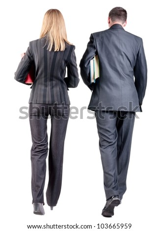 Back view of  walking business team. Going young couple (man and woman) with books.   Rear view people collection.  backside view of person.  Isolated over white background.