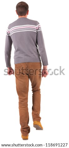 Back view of walking   man in sweater and brown jeans.   young guy in jeans and  jacket. Rear view people collection.  backside view of person.  Isolated over white background.