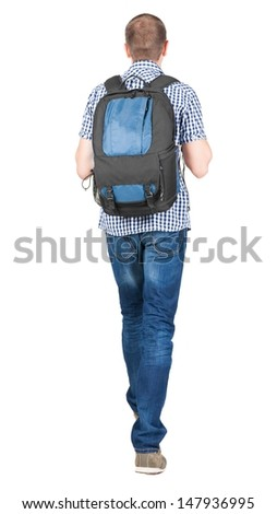 back view of walking  man  with backpack.  brunette guy in motion. backside view of person.  Rear view people collection. Isolated over white background.