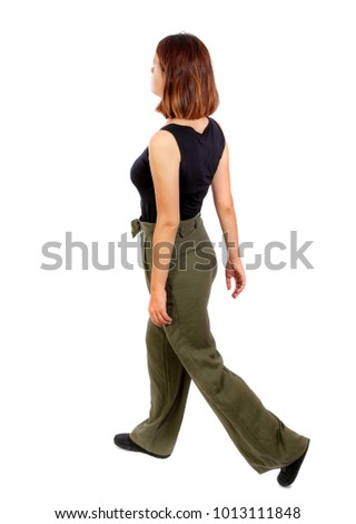 back view of walking  woman. beautiful blonde girl in motion.  backside view of person.  Rear view people collection. Isolated over white background. Top view of a girl in green trousers leaving in