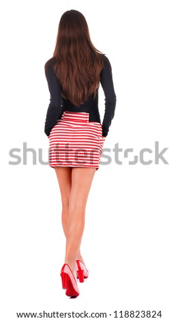 back view of walking  woman  in red dress. beautiful brunette girl in motion.  backside view of person.  Rear view people collection. Isolated over white background.
