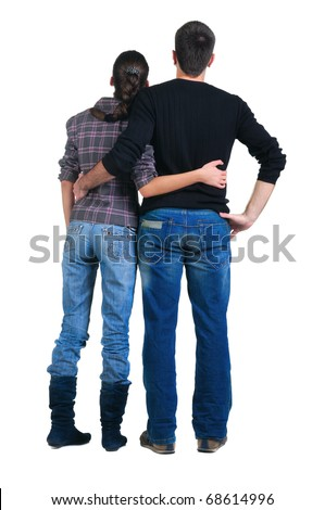 Back view of watching young couple . Rear view. Isolated over white.