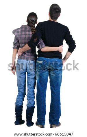 Back view of watching young couple. Rear view. Isolated over white.