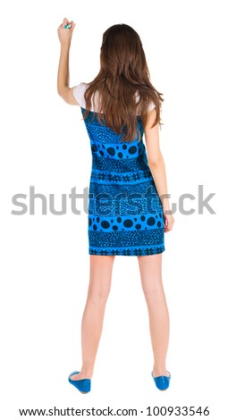 back view of writing beautiful brunette woman. Young girl in blue dress draws. Rear view people collection.  backside view of person. Isolated over white background.