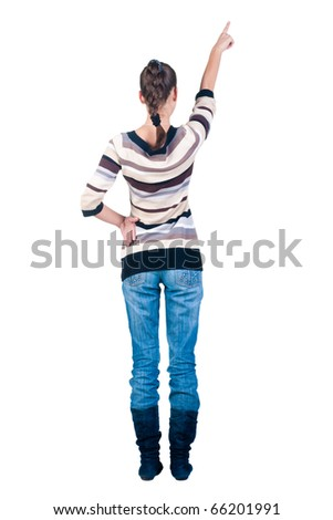 Back view of young beautiful woman pointing at wall. Rear view. Isolated over white background.