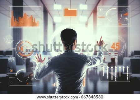 Shutterstock Back view of young businessman managing business charts in modern interior. Economy concept. 3D Rendering