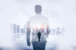 Back view of young businessman walking on abstract city background. Success and development concept. Double exposure