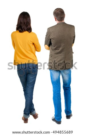 Back view of young couple man and woman hug and look into the distance. beautiful friendly girl and guy together. Rear view. Isolated over white background. young woman holds the hand of her husband #494855689