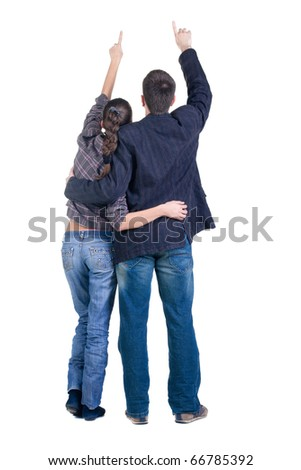 Back view of young couple pointing at wall. Rear view. Isolated over white background.