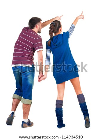 back view of young couple pointing at white wall . young pair interestedly looks.  Rear view people collection.  backside view of person.  Isolated over white background.
