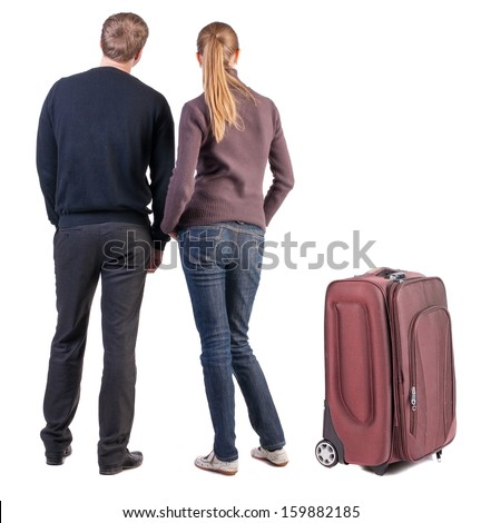 Back view of young couple traveling with suitcas . beautiful friendly girl and guy together. Rear view. Isolated over white background.