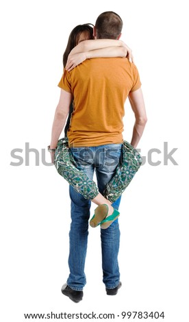 Back view of young heterosexual couple embracing. rear view people. Isolated over white background.