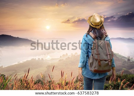 Back view of Young hiker woman in park on day light summer time, Travel concept