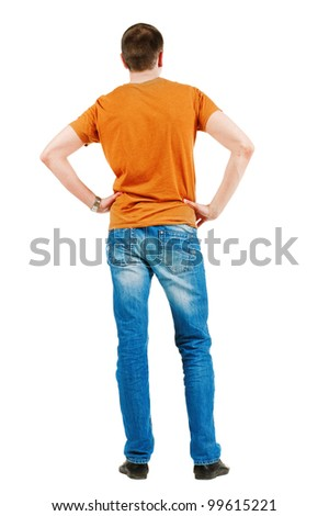 Back view of young men in  orange t-shirt. Guy looks at wall. Rear view. Isolated over white background - stock photo