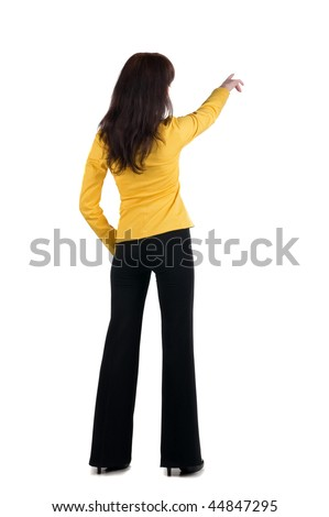Back view of young woman in yellow suit points at wall. rear view . More Similar Images http://www.shutterstock.com/sets/16511-back-side-people-woman-and-man-isolated-over-white.html?rid=311293