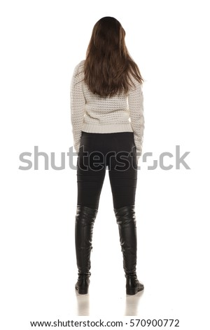 back view of young woman standing on white background