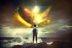 Back view portrait of young man standing against the sea with big wave beating with splash in a stair to heaven ,Conceptual of freedom life.