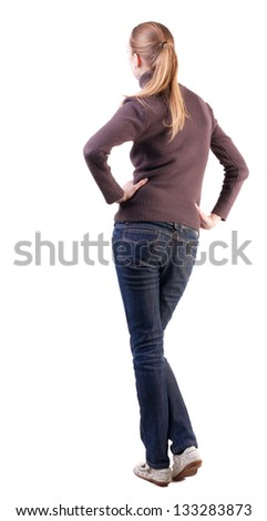 back view standing young beautiful  blonde woman. girl watching. Rear view people collection. backside view person Isolated over white background. girl looks forward placing hands on hips