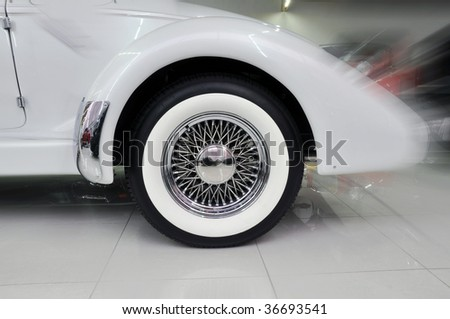 back wheel of an old car in a store - stock photo