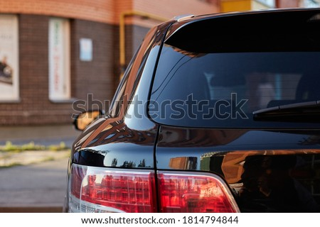 Back window of a car parked on the street in summer sunny day, rear view. Mock-up for sticker or decals ストックフォト ©
