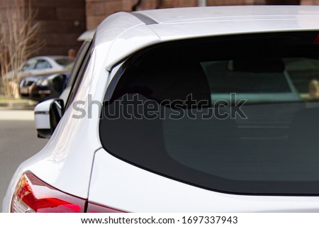 Back window of a white car parked on the street, rear view. Mock-up for sticker or decals ストックフォト ©