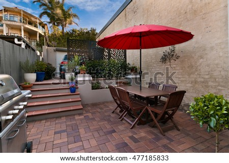 back yard with outdoor seating and barbecue with family #477185833