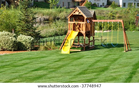Back Yard Wooden Swing Set On Green Lawn Ez Canvas