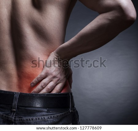 Backache. Pain in the lower back. Man's back