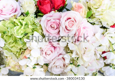Backdrop of colorful paper roses background in a wedding