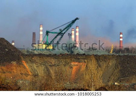 Backfilling of a submerged iron ore quarry with a walking excavator #1018005253