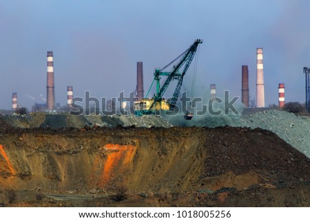 Backfilling of a submerged iron ore quarry with a walking excavator #1018005256