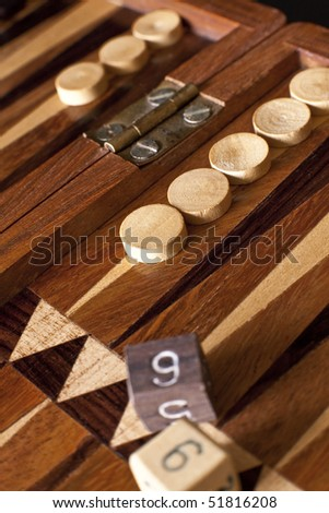 Backgammon board in wood with dices on it.
