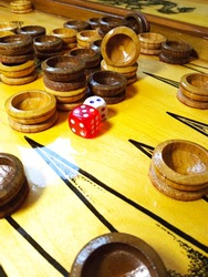 Backgammon, other common names: trick-track, backgammon, tavla, shesh-besh, kosha - a board game for two players on a special board divided into two halves.