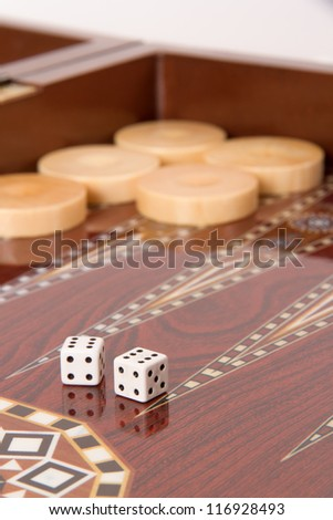 Backgammon table, chips and dices with double six.
