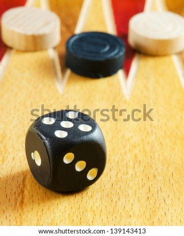 Backgammon table ,dice and pieces (closeup image)