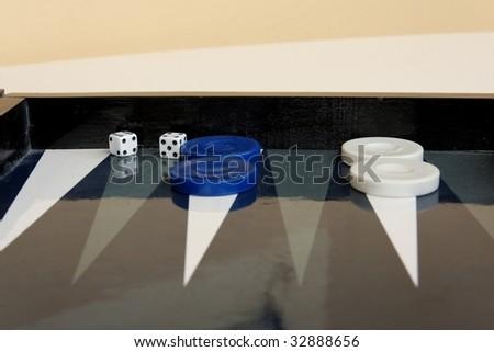 Backgammon table dice checkers closeup