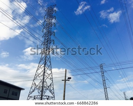 Background and Landscape: Light towers , high voltage pole and wires #668862286