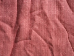 Background and texture of creased pink or old rose fabric. (close up, top view, space for text, article layout design)