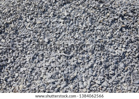 Background and texture of gray granite rubble. Breakstone, rubble stones