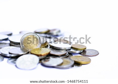 Background and texture of many coins from many country isolated on white background,Focus on 2 euro coin