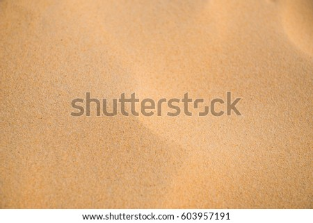 background and texture of  sand pattern on a beach in summer #603957191