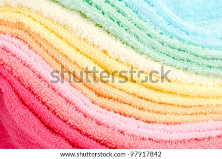 Background and texture of several color laden towels to curve