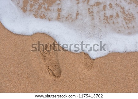 background and texture. the footprints on the sand, beach by the sea. Which is a tourist attraction in the holidays summer. #1175413702