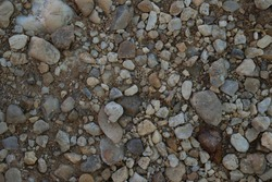 Background and textured of ground with stones sprinkled.