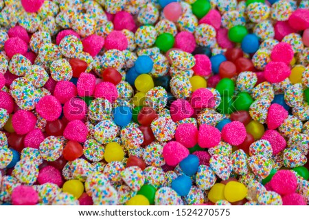 Background - assortment of delicious marmalade jelly candies for sale on counter of shop, grocery, market, cafe. Dessert, copy space, sweet food, pattern and confectionery concept